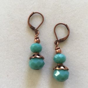 Opaque turquoise crystal and copper earrin…